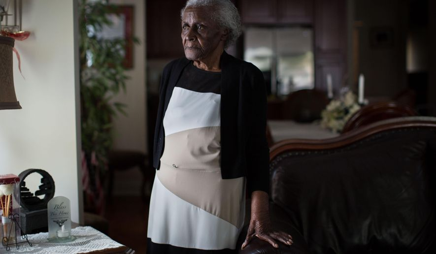 In this Sept. 24, 2015, photo, Mattie Jackson, 93, poses for a portrait in her home in the Peoplestown neighborhood in Atlanta. Jackson, who has lived there for more than 50 years, is leading a charge with other residents in fighting the City of Atlanta's plan to turn a portion of the neighborhood into a park and retention pond. The City says this is necessary because of a sewage issue that may cause flooding in the area. (AP Photo/Kevin D. Liles)