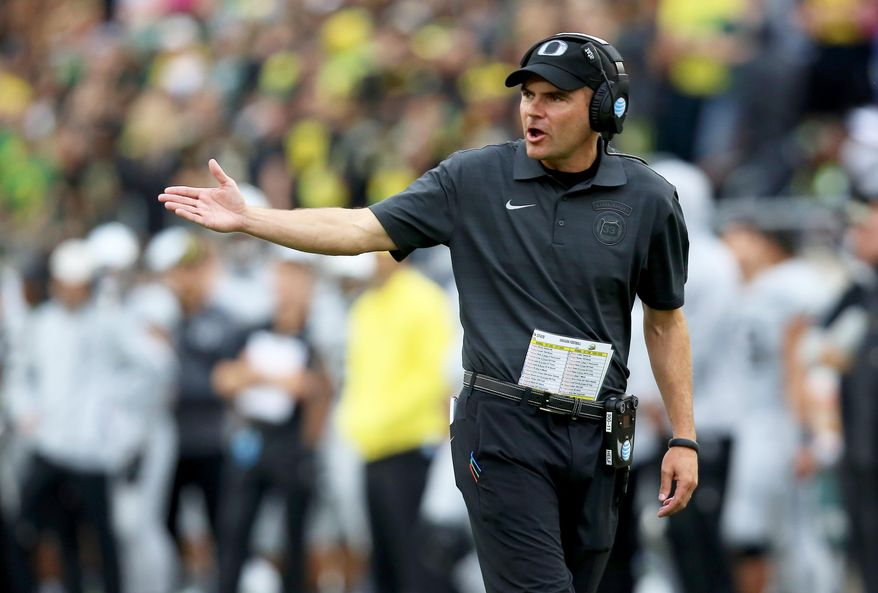 Oregon head coach Mark Helfrich talks to the referees during the first half of an NCAA college football game against Washington State Saturday, Oct. 10, 2015, in Eugene, Ore. (AP Photo/Ryan Kang)