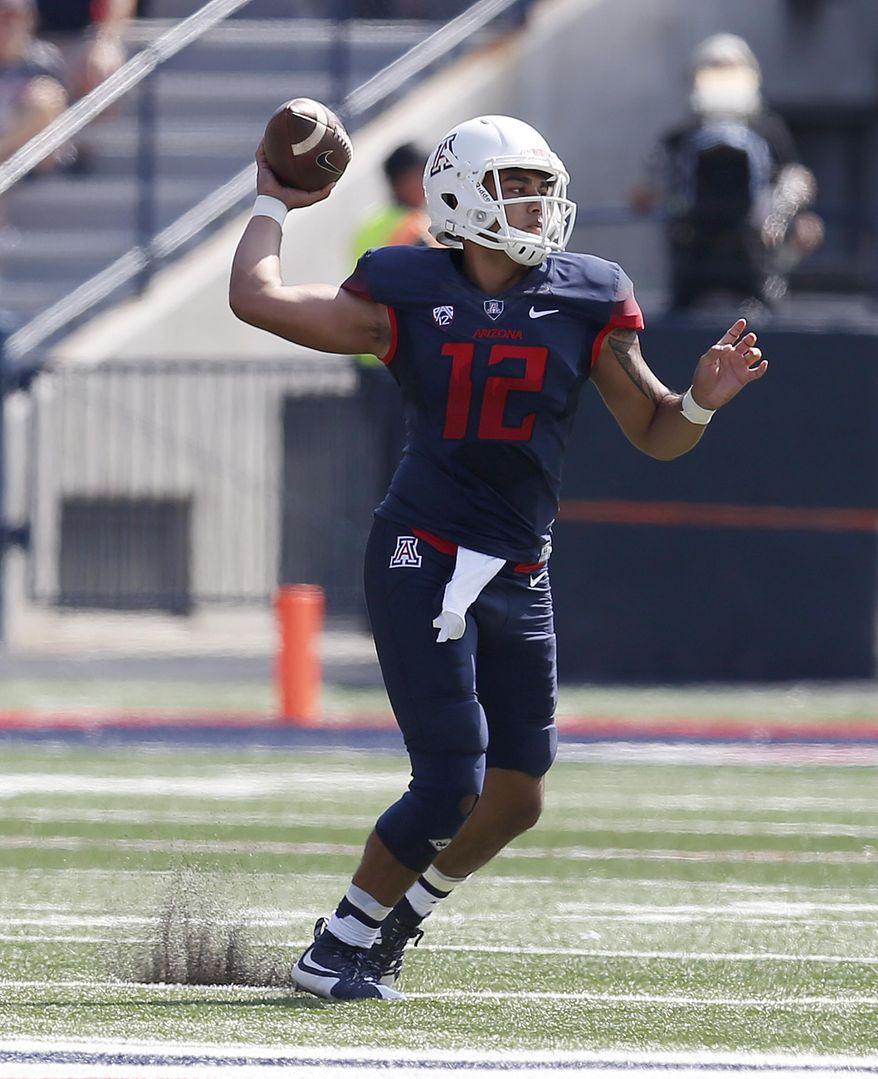Arizona quarterback Anu Solomon throws down field against Oregon State during the first half of an NCAA college football game, Saturday, Oct. 10, 2015, in Tucson, Ariz. (AP Photo/Rick Scuteri)