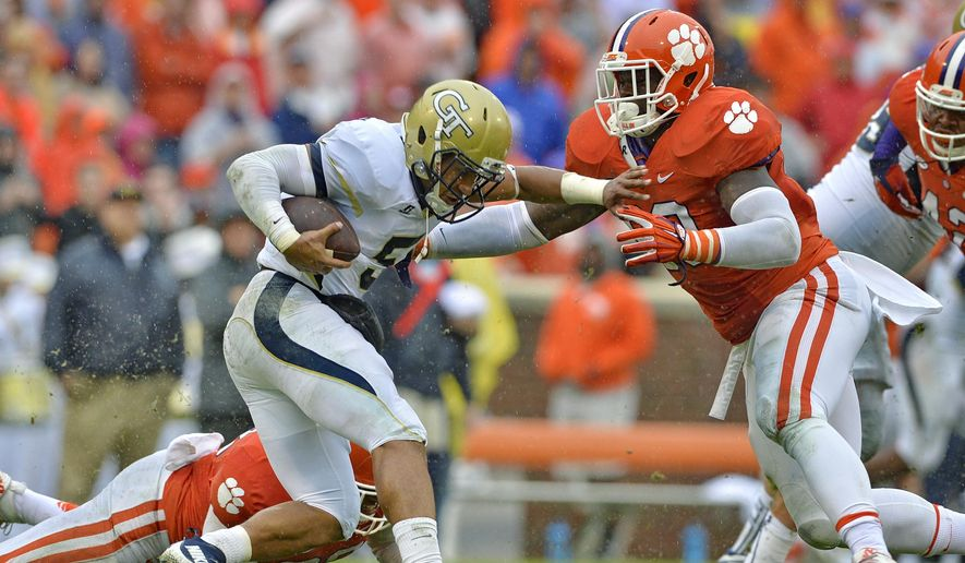 Georgia Tech quarterback Justin Thomas is sacked by Clemson's Shaq Lawson during the first half of an NCAA college football game Saturday, Oct. 10, 2015, in Clemson,  S.C. (AP Photo/Richard Shiro)