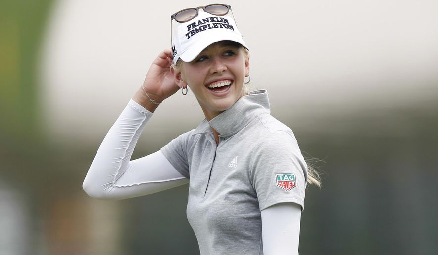 Jessica Korda of the United States laughs as she walks towards the 18th green during the third round of the LPGA Malaysia golf tournament at Kuala Lumpur Golf and Country Club in Kuala Lumpur, Malaysia, Saturday, Oct. 10, 2015. (AP Photo/Joshua Paul)