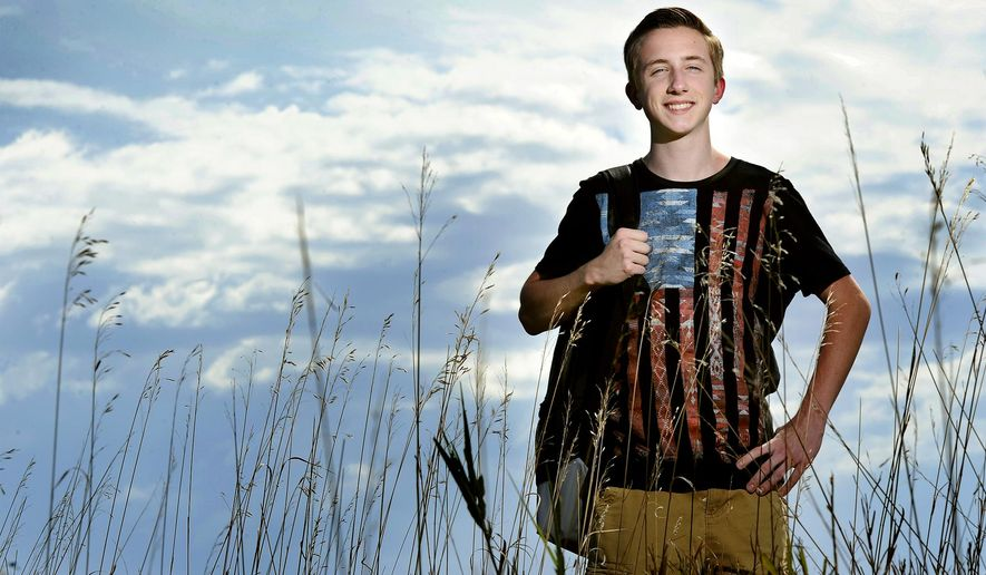 "ADVANCE FOR THE WEEKEND OF OCT. 10-11 AND THEREAFTER - Lincoln high school junior Kyler Johnson, a student of meteorology seen in a Sept. 22, 2015 photo in Lincoln, Neb., has a place on Lincoln Public Schools Superintendent Steve Joel's weather advisory team and has now won the ""Excellence in Risk Communication Award"" from the governor's office.   (Eric Gregory/Lincoln Journal Star via AP)"