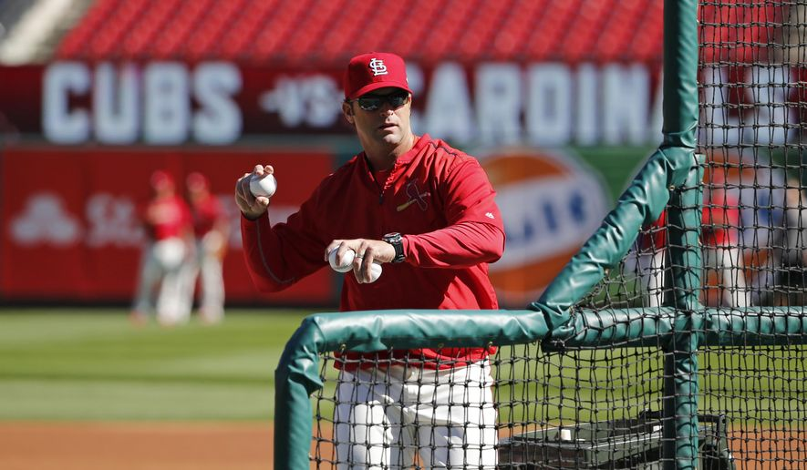 St. Louis Cardinals manager Mike Matheny throws batting practice before Game 2 in baseball's National League Division Series against the Chicago Cubs, Saturday, Oct. 10, 2015, in St. Louis. (AP Photo/Charles Rex Arbogast)