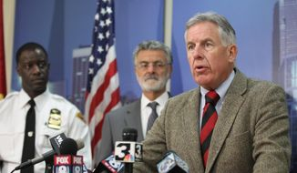 In this Oct. 2, 2015, file photo, Cuyahoga County Prosecutor Timothy McGinty speaks during a news conference at police headquarters, in Cleveland. A white Cleveland police officer was justified in fatally shooting a black 12-year-old boy holding a pellet gun moments after pulling up beside him, according to two outside reviews conducted at the request of the prosecutor investigating the death. (Lisa DeJong/The Plain Dealer via AP, File)