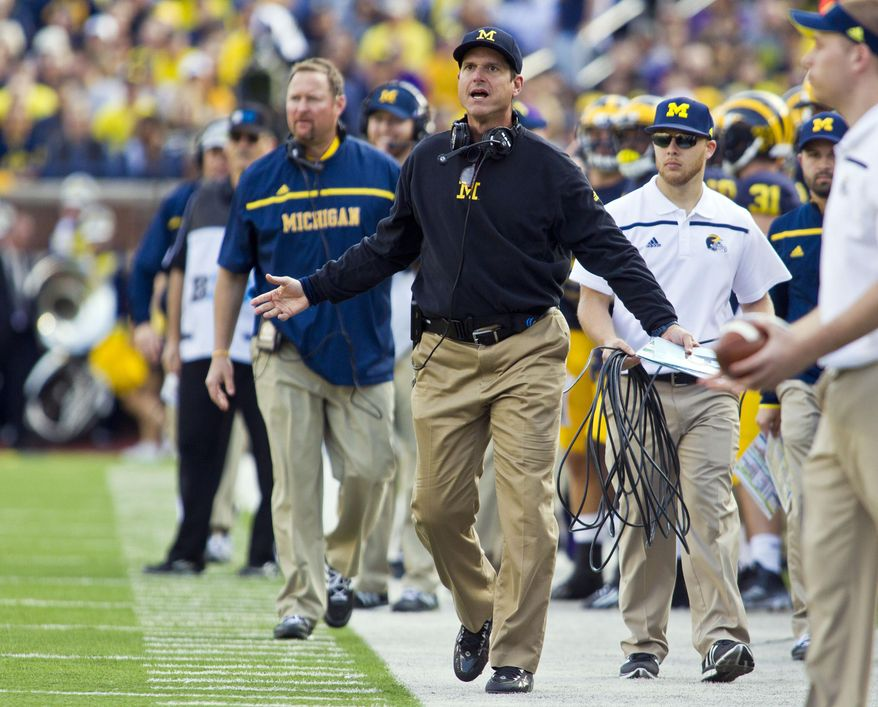 Michigan head coach Jim Harbaugh reacts on the sideline in the second quarter of an NCAA college football game against Northwestern in Ann Arbor, Mich., Saturday, Oct. 10, 2015. (AP Photo/Tony Ding)
