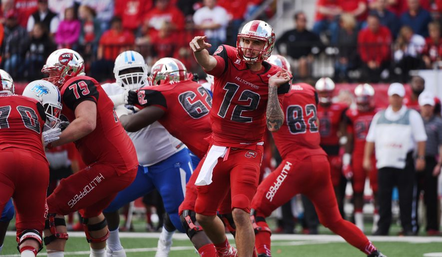 Western Kentucky quarterback Brandon Doughty (12) throws a pass against the Middle Tennessee during the first half an NCAA college football game on Saturday, Oct. 10, 2015, at L.T. Smith Stadium in Bowling Green, Ky. (AP Photo/Michael Noble Jr.)