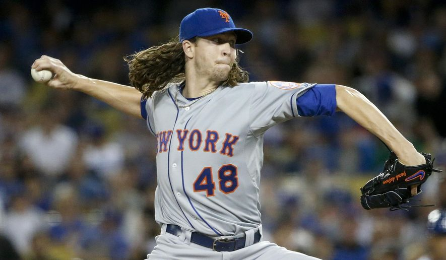 New York Mets starting pitcher Jacob deGrom throws against the Los Angeles Dodgers during the first inning in Game 1 of baseball's National League Division Series, Friday, Oct. 9, 2015 in Los Angeles. (AP Photo/Lenny Ignelzi)