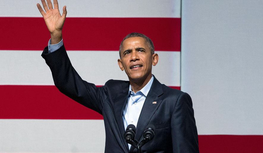 President Barack Obama waves to guests as he takes the stage during a Democratic fundraiser at the Warfield Theater, Saturday, Oct. 10, 2015 in San Francisco. (AP Photo/Pablo Martinez Monsivais)