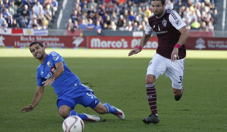Colorado Rapids defender Drew Moor, right, pursues the ball with Montreal Impact midfielder/defender Maxim Tissot in the first half of an MLS soccer match in Commerce City, Colo., Saturday, Oct. 10, 2015. (AP Photo/David Zalubowski)