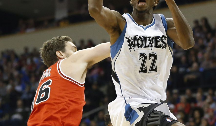 Minnesota Timberwolves' Andrew Wiggins, (22) goes up for two against Chicago Bulls' Pau Gasol (16) during the first half of an NBA preseason basketball game, Saturday, Oct. 10, 2015 in Winnipeg, Manitoba. (John Woods/The Canadian Press via AP) MANDATORY CREDIT