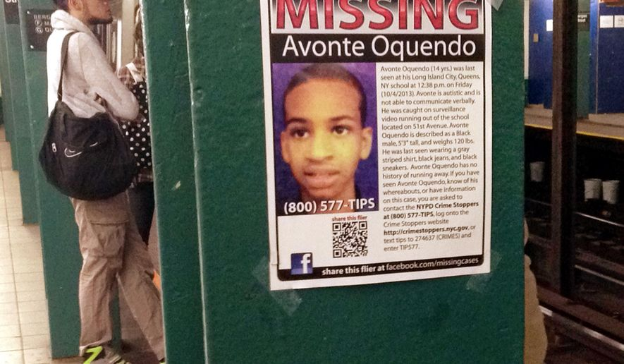 FILE - In this Oct. 21, 2013, file photo, a missing poster displayed in a New York subway station asks for help in finding Avonte Oquendo, an autistic 14-year-old who was last seen walking out of his Queens school toward a park overlooking the East River. Oquendo's remains were found in the East River in January 2014, several miles from where he vanished. Two years after his death, New York City teachers and school employees are receiving additional training on serving autistic pupils. (AP Photo/Barbara Woike, File)