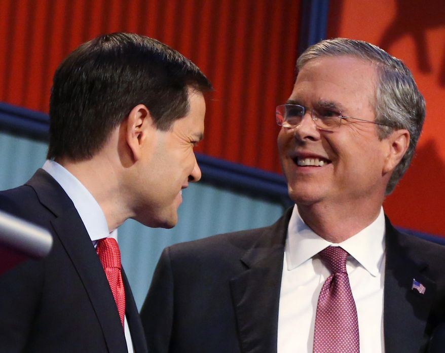 In this Aug. 6, 2015, file photo, Republican presidential candidates Marco Rubio, left, and Jeb Bush talk during a break during the first Republican presidential debate at the Quicken Loans Arena in Cleveland. (AP Photo/Andrew Harnik)