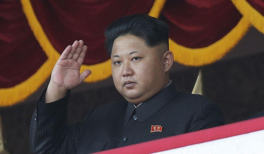 North Korean leader Kim Jong-un gestures as he watches a military parade in Pyongyang, North Korea, Saturday, Oct. 10, 2015. (AP Photo/Wong Maye-E) ** FILE **