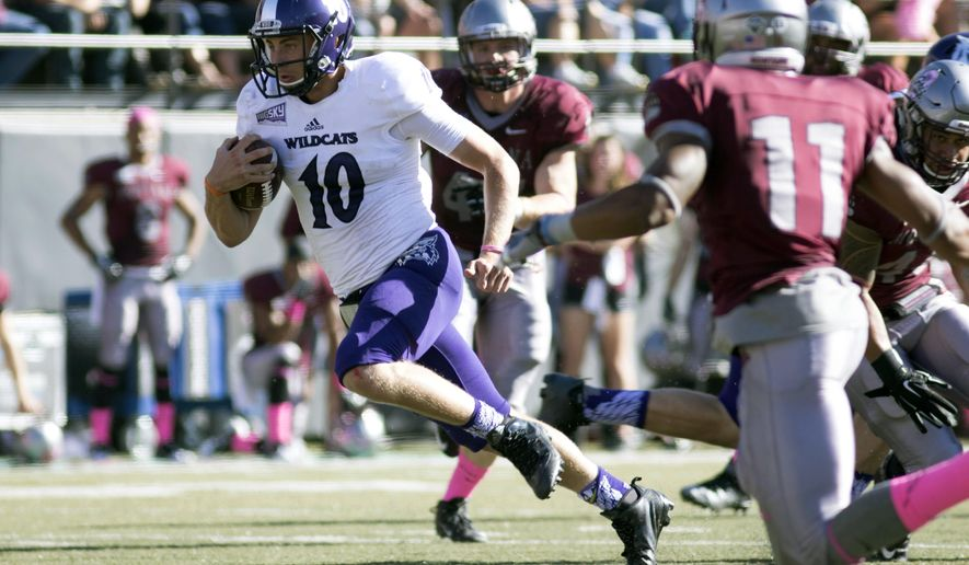 Weber State quarterback Jadrian Clark (10) rushes with the ball against Montana in the first half of an NCAA college football game Saturday, Oct. 10, 2015, in Missoula, Mont. (AP Photo/Patrick Record)