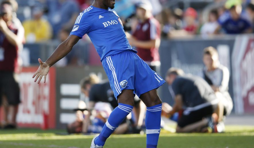 Montreal Impact forward Didier Drogba celebrates after making penalty kick against Colorado Rapids in the first half of an MLS soccer match in Commerce City, Colo., Saturday, Oct. 10, 2015. (AP Photo/David Zalubowski)