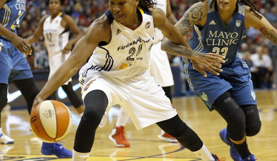 Indiana Fever forward Tamika Catchings (24) drives the ball against Minnesota Lynx guard Seimone Augustus (33) in the first half of Game 3 of the WNBA Finals basketball series, Friday, Oct. 9, 2015, in Indianapolis. (AP Photo/AJ Mast)