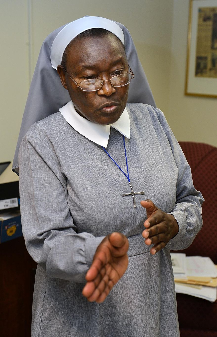 ADVANCE FOR USE SUNDAY, OCT. 11 - In this photo taken Aug. 19, 2015, Sister Agatha Munyanyi describes how water samples are taken close to possible sources of  pollution in Charleston, W.V.a. Munyanyi, who has lived in Charleston in community with two other sisters, is a staff scientist with Potesta & Associates Inc., an engineering and environmental consulting firm. (Craig Cunningham/Charleston Gazette-Mail via AP) MANDATORY CREDIT MBO (REV-SHARE)\