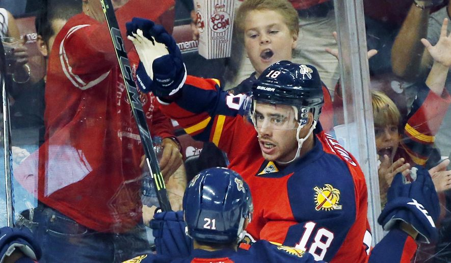 Florida Panthers right wing Reilly Smith (18) and center Vincent Trocheck (21) celebrate after Smith scored a goal during the first period of an NHL hockey game against the Philadelphia Flyers, Saturday, Oct. 10, 2015, in Sunrise, Fla. (AP Photo/Wilfredo Lee)