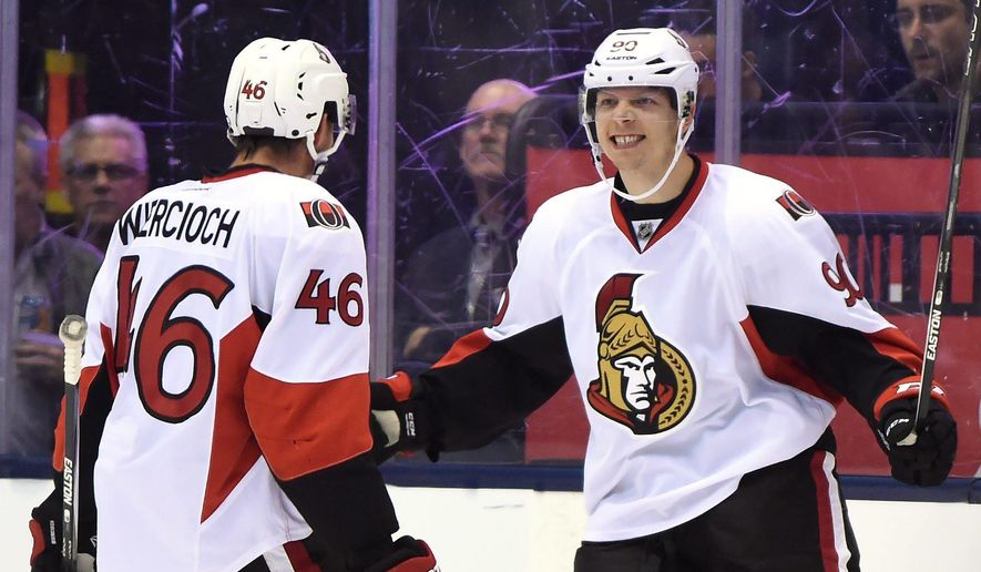 Ottawa Senators' Alex Chiasson, right, celebrates after scoring the second goal against the Toronto Maple Leafs during the second period of an NHL hockey game against the Ottawa Senators in Toronto, Saturday, Oct. 10, 2015. (Frank Gunn/The Canadian Press via AP) MANDATORY CREDIT