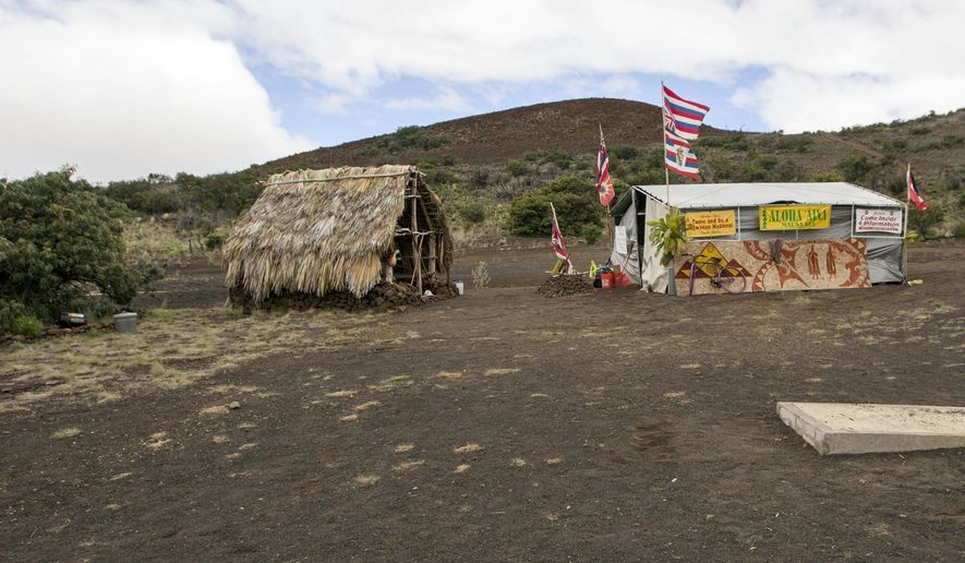 FILE - In this Aug. 31, 2015, file photo, the base camp for protesters of the Thirty Meter Telescope project occupies a site near the summit of Mauna Kea on Hawaii's Big Island. A judge issued a decision late Friday, Oct. 9, 2015, invalidating the state's emergency rule aimed at curbing protests against the construction of the telescope, the Honolulu Star Advertiser reported  (AP Photo/Caleb Jones, File)