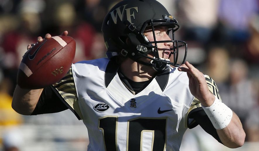 Wake Forest quarterback John Wolford (10) looks to pass during the first quarter of an NCAA college football game against Boston College in Boston, Saturday, Oct. 10, 2015. (AP Photo/Michael Dwyer)