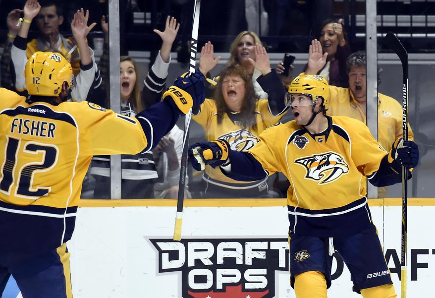Nashville Predators right wing Craig Smith, right, celebrates after scoring a goal against the Edmonton Oilers in the second period of an NHL hockey game Saturday, Oct. 10, 2015, in Nashville, Tenn. (AP Photo/Mark Zaleski)