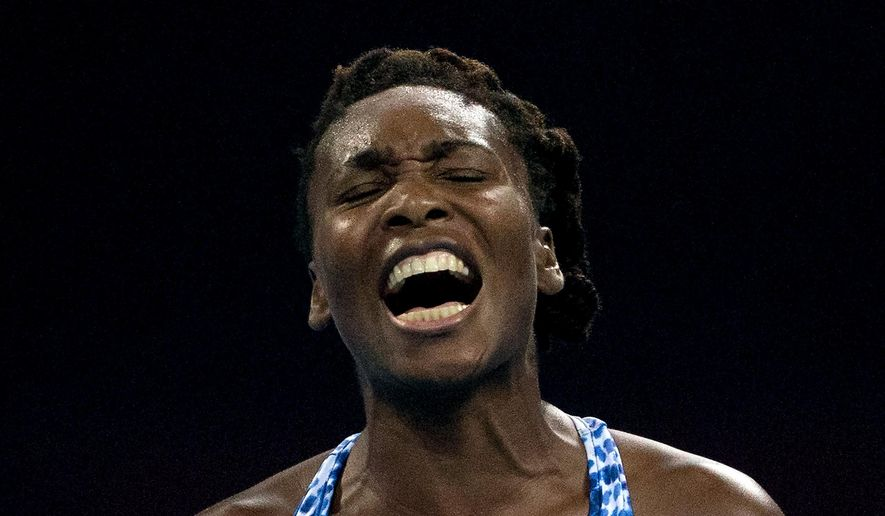 Venus Williams of the United States reacts after missing a point to Ana Ivanovic of Serbia during the second round women's singles match of the China Open tennis tournament at the National Tennis Stadium in Beijing, Tuesday, Oct. 6, 2015. (AP Photo/Andy Wong)