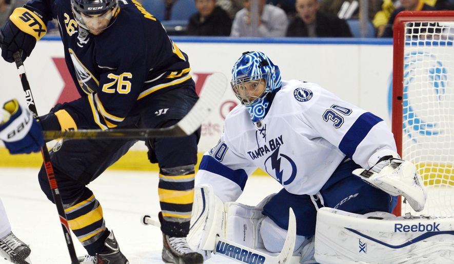 Buffalo Sabres left winger Matt Moulson (26) battles for a loose puck in front of Tampa Bay Lightning goaltender Ben Bishop (30) during the third period of an NHL hockey game, Saturday, Oct. 10, 2015, in Buffalo, N.Y.  Tampa Bay won 4-1. (AP Photo/Gary Wiepert)