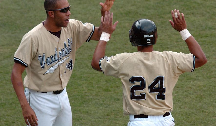 FILE - In this May 27, 2007, file photo, Vanderbilt pitcher David Price, left, congratulates Pedro Alvarez after he scored in the seventh inning against Arkansas in the Southeastern Conference baseball tournament championship game in Hoover, Ala. Price is a pitcher for the 2015 Toronto Blue Jays baseball team. (AP Photo/Dave Martin, File)