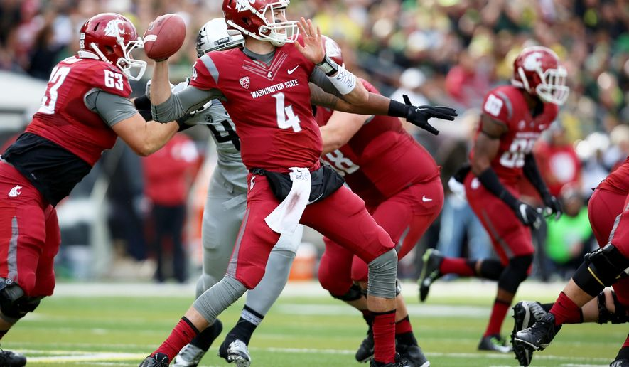 Washington State quarterback Luke Falk (4) looks to throw the football during the first half of an NCAA college football game against Oregon Saturday, Oct. 10, 2015, in Eugene, Ore. (AP Photo/Ryan Kang)