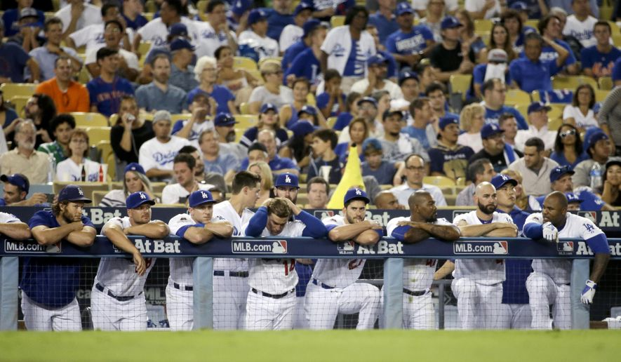 Members of the Los Angeles Dodgers react to their 3-1 loss against the New York Mets in Game 1 of baseball's National League Division Series, Friday, Oct. 9, 2015 in Los Angeles.  AP Photo/Gregory Bull)