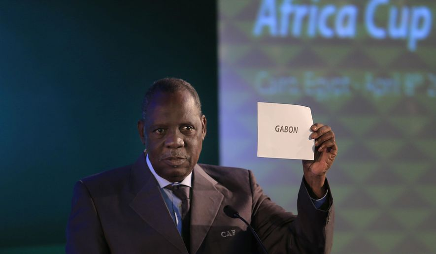 FILE - In this April 8, 2015 file photo, President of the Confederation of African Football, Issa Hayatou, announces that Gabon will be hosting the 2017 African Cup of Nations at a meeting of the confederation's executive committee, in Cairo, Egypt. FIFA said Thursday, Oct. 8, 2015 that African soccer leader Isaa Hayatou will serve as acting president.    (AP Photo/Hassan Ammar,File)