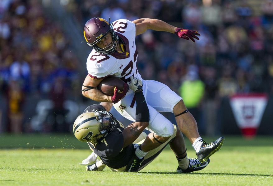 Minnesota running back James Johannesson (27) is brought down by Purdue safety Robert Gregory (7) during the first half of an NCAA college football game, Saturday, Oct. 10, 2015, in West Lafayette, Ind. (AP Photo/Doug McSchooler)