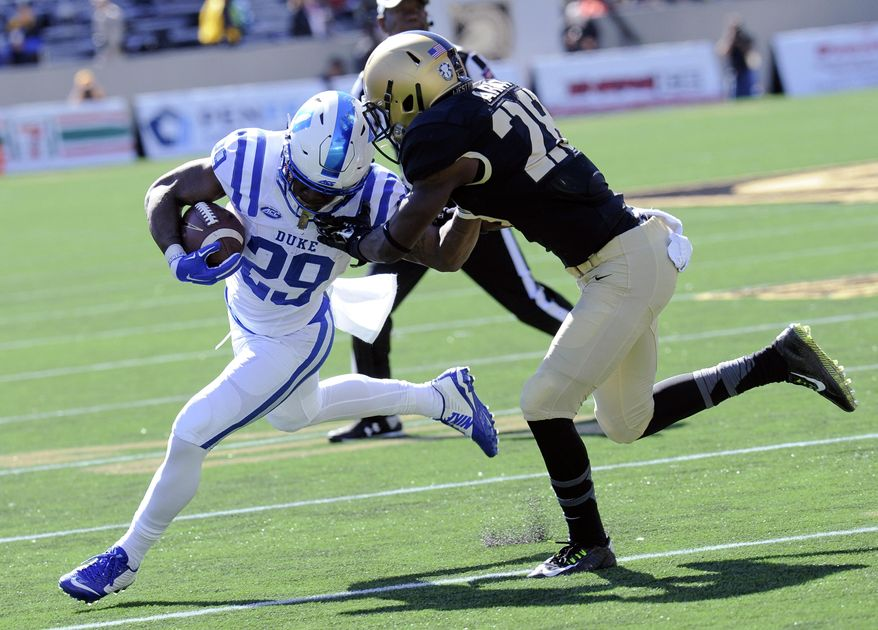 Duke running back Shaun Wilson (29) runs the ball while being defended by Army cornerback Brandon Jackson (28) during the first half of an NCAA college football game, Saturday, Oct. 10, 2015, in West Point, N.Y. (AP Photo/Hans Pennink)