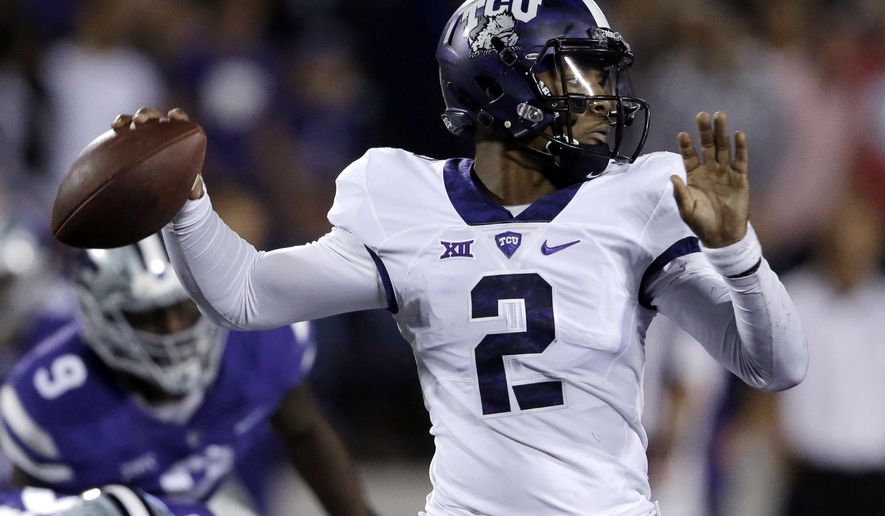 TCU quarterback Trevone Boykin (2) passes to a teammate during the first half of an NCAA college football game against Kansas State in Manhattan, Kan., Saturday, Oct. 10, 2015. (AP Photo/Orlin Wagner)