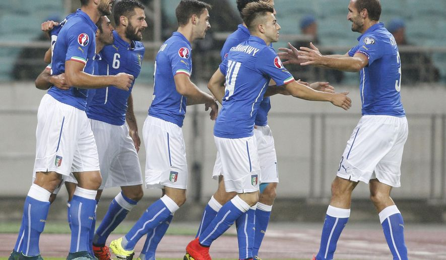 Italy's players celebrate after scoring goal during the Euro 2016 group H qualifying soccer match between the Azerbaijan and Italy at the Olympic stadium in Baku, Azerbaijan, Saturday, Oct. 10, 2015. (AP Photo/Mindaugas Kulbis)