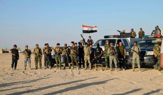 Sunni volunteer tribal fighters deploy as they support the Iraqi security forces in liberating the city of Ramadi, Iraq, from Islamic State group militants, in the eastern suburbs of Ramadi, the capital of Iraq's Anbar province, 70 miles (115 kilometers) west of Baghdad, Sunday, Oct. 11, 2015. (AP Photo)