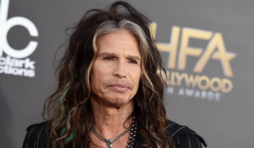 "FILE - In this Friday, Nov. 14, 2014, file photo, Steven Tyler arrives at the Hollywood Film Awards at the Palladium, in Los Angeles. Aerosmith frontman Tyler is asking Republican presidential candidate Donald Trump to stop using the power ballad ""Dream On"" at campaign events. (Photo by Jordan Strauss/Invision/AP, File)"