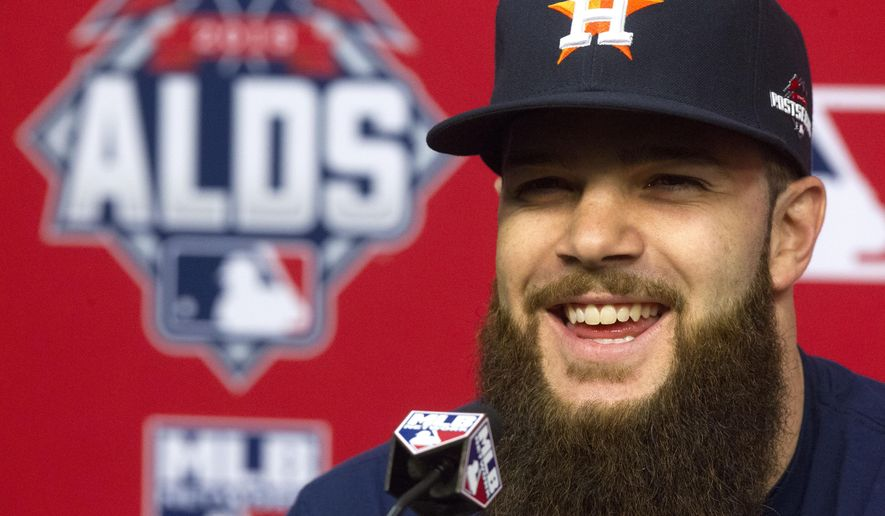 Houston Astros pitcher Dallas Keuchel speaks during a news conference for baseball's American League Division Series, Saturday, Oct. 10, 2015, in Houston. The Astros host the Kansas City Royals in Game 3 on Sunday. The best-of-five games series is tied 1-1.  (AP Photo/Patric Schneider)
