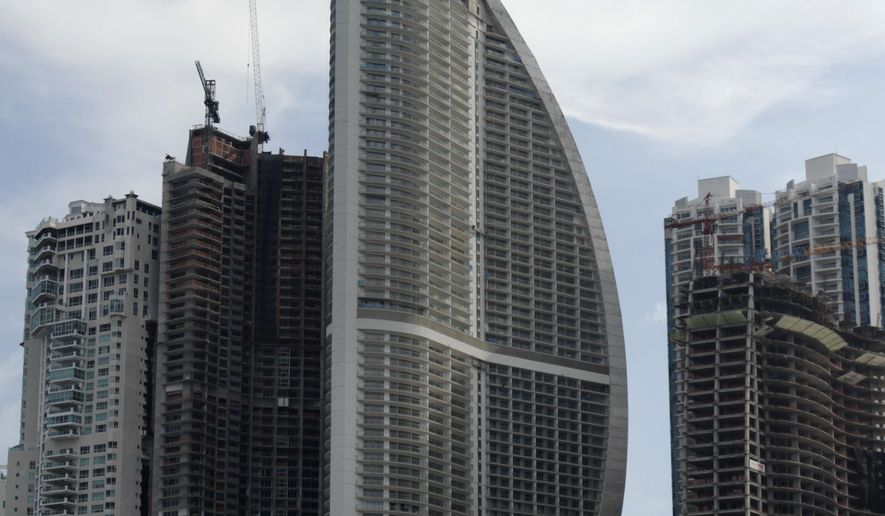 FILE - This July 4, 2011, file photo, shows the Trump Ocean Club International Hotel and Tower, third building from left, in Panama City, Panama. The tale of a 70-story waterfront tower along Panama Bay that was managed by the Trump empire offers insight into the Republican presidential candidate's business traits, and hints about the management style that might be expected from a Trump White House. (AP Photo/Arnulfo Franco)