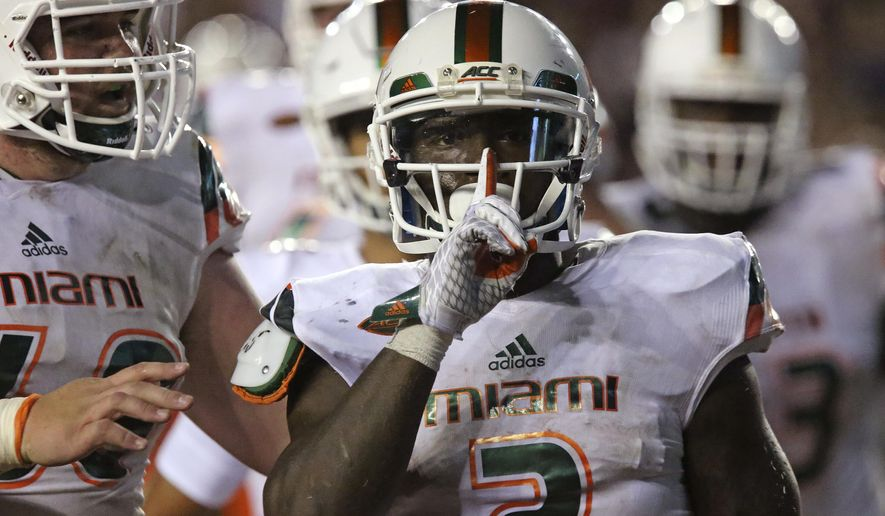 Miami's Joe Yearby celebrates scoring a touchdown against Florida State in the third quarter of an NCAA college football game, Saturday, Oct. 10, 2015 in Tallahassee, Fla. Florida State won the game 29-24. (AP Photo/Steve Cannon)