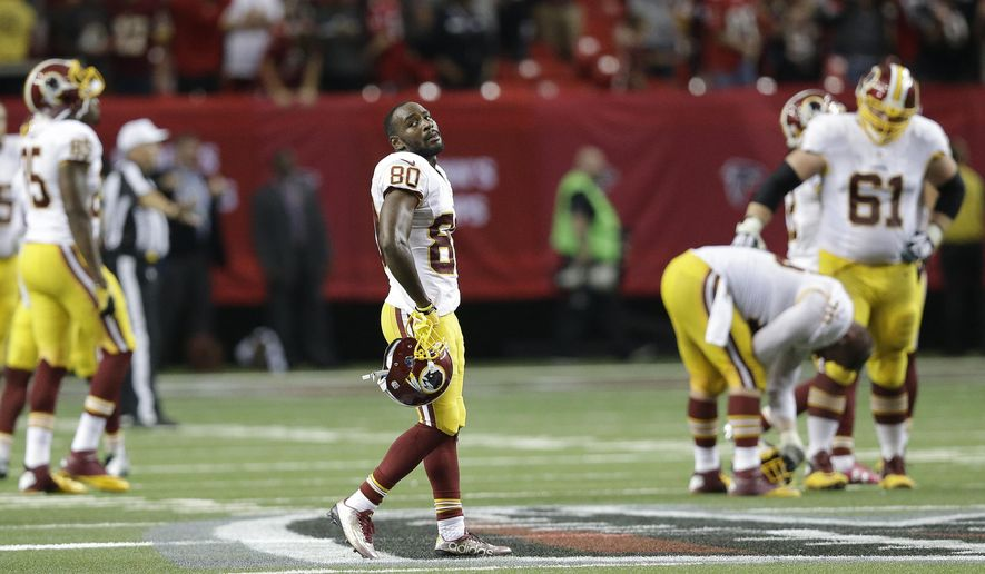 Washington Redskins wide receiver Jamison Crowder (80) looks toward the scoreboard during the overtime of an NFL football game against the Atlanta Falcons, Sunday, Oct. 11, 2015, in Atlanta. The Atlanta Falcons won 25-19. (AP Photo/Brynn Anderson)