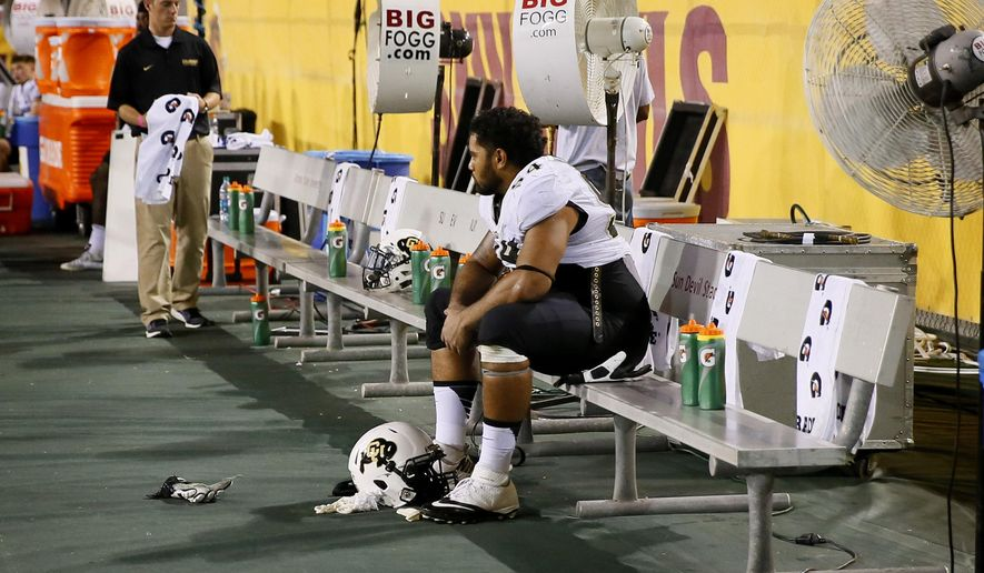 Colorado defensive lineman Samson Kafovalu (54) sits on the bench during the second half of an NCAA college football game against Arizona State, Saturday, Oct. 10, 2015, in Tempe, Ariz. Arizona State won 48-23. (AP Photo/Matt York)