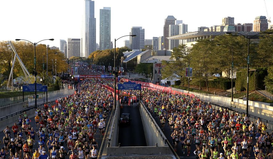 Runners participate in the Chicago Marathon, Sunday, Oct. 11, 2015, in Chicago. (AP Photo/Nam Y. Huh)