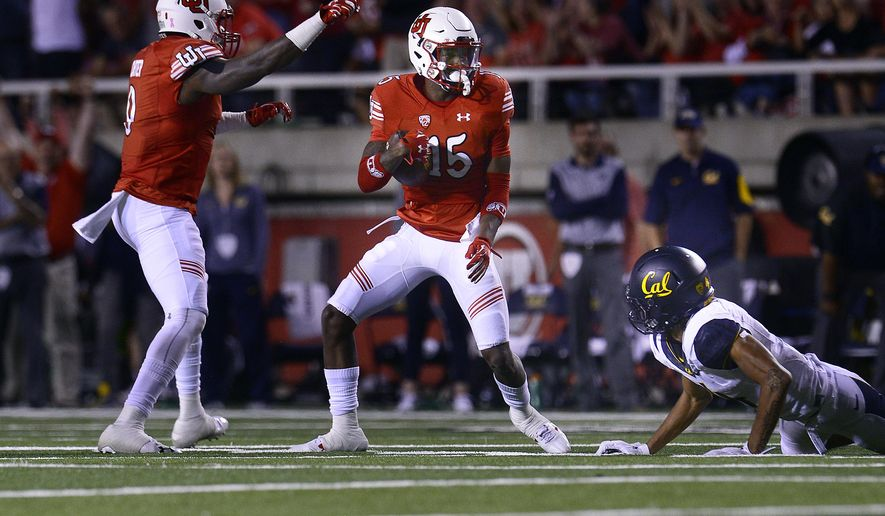 Utah's Dominique Hatfield grabs an interception away from California's Kenny Lawler in the first half during an NCAA college football game Saturday, Oct. 10, 2015, in Salt Lake City. (Scott Sommerdorf/The Salt Lake Tribune via AP) DESERET NEWS OUT; LOCAL TELEVISION OUT; MAGS OUT; MANDATORY CREDIT