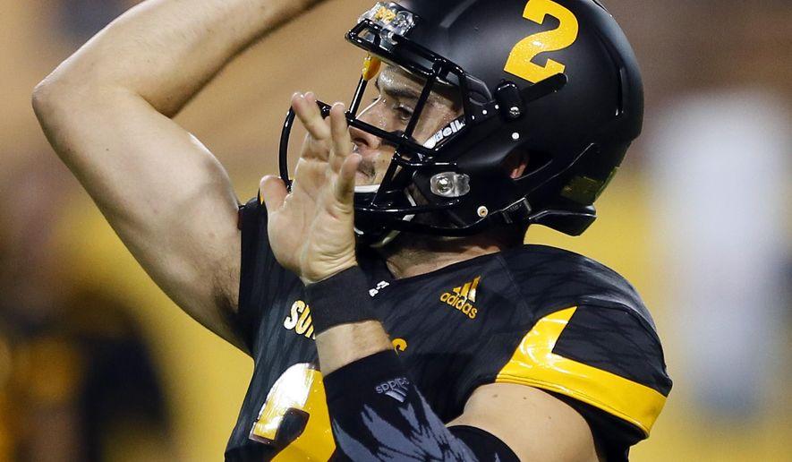 Arizona State quarterback Mike Bercovici (2) warms up prior to an NCAA college football game against Colorado, Saturday, Oct. 10, 2015, in Tempe, Ariz. (AP Photo/Matt York)