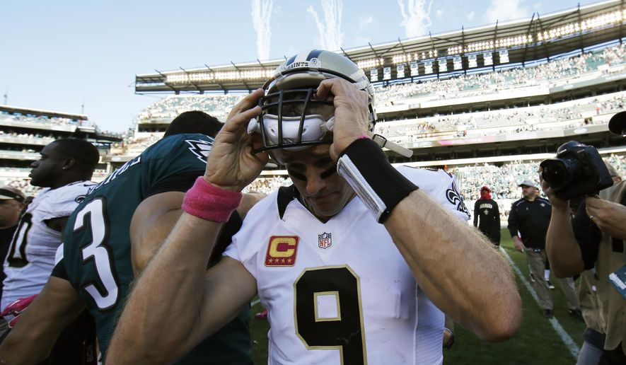 New Orleans Saints' Drew Brees takes his helmet off after an NFL football game against the Philadelphia Eagles, Sunday, Oct. 11, 2015, in Philadelphia. Philadelphia won 39-17. (AP Photo/Michael Perez)