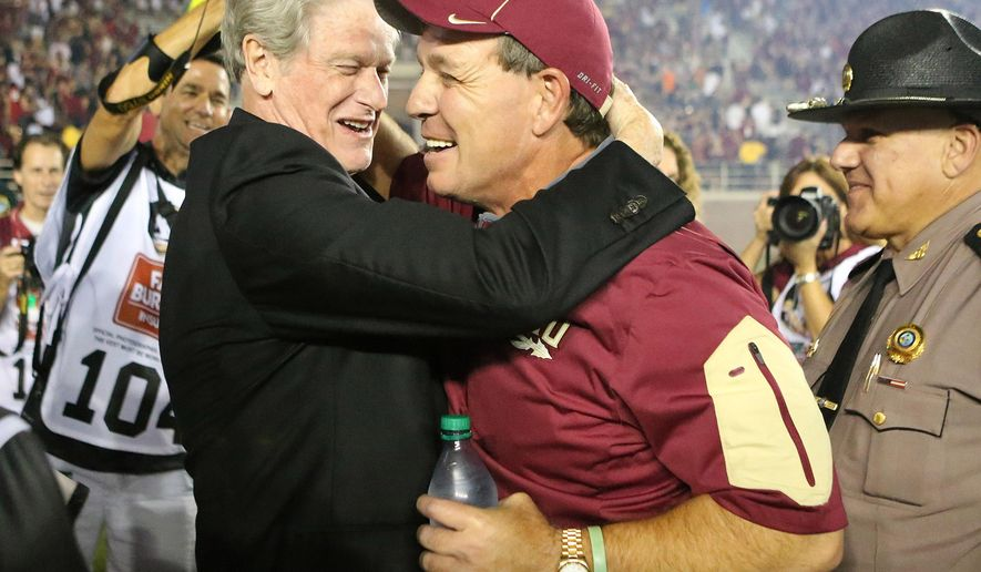 Florida State head coach Jimbo Fisher, right, is congratulated by Florida State president John Thrasher after beating Miami in an NCAA college football game, Saturday, Oct. 10, 2015 in Tallahassee, Fla. Florida State won the game 29-24. (AP Photo/Steve Cannon)