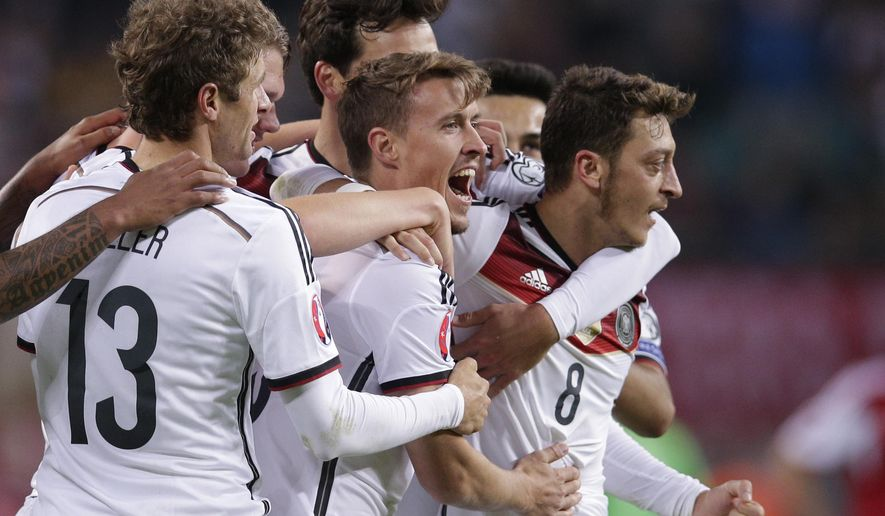 Germany's Max Kruse, center, celebrates after scoring his side's second goal during the Euro 2016 group D qualifying soccer match between Germany and Georgia in Leipzig, Germany, Sunday, Oct. 11, 2015. (AP Photo/Michael Sohn)