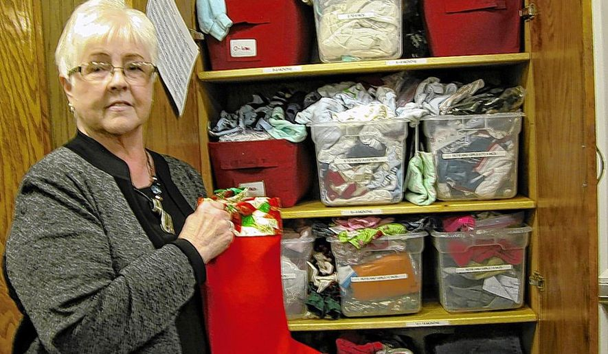 In this Oct. 6, 2015 photo, Joni Cannon, president of Cap the Gap for Foster Care, shows off one of the cabinets filled with infant clothing, in Elizabethton, Tenn. She said was inspired by the outstanding work being done by the Sullivan County Cap the Gap. Cannon said the cap being closed refers to the gap between being a foster child and being a child being nurtured in a loving family. (John Thompson/The Johnson City Press via AP) MANDATORY CREDIT